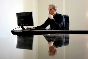A business man ponders his content marketing strategy for his medium-sized enterprise.