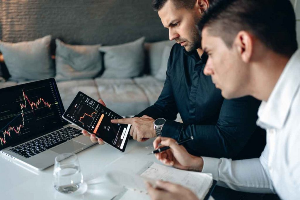 Two men work together to perform a keyword analysis in this file image.